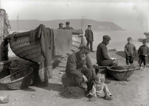 Men with line baskets on the beach at cromarty