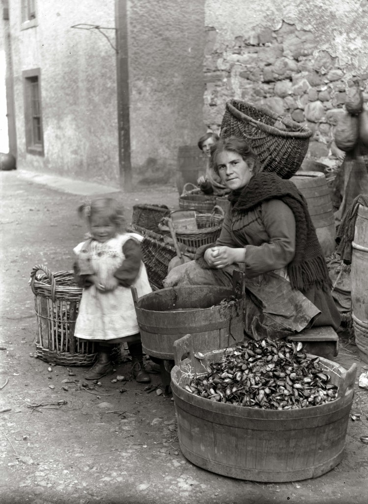 Woman preparing mussels for bait