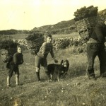 John Gillies with his sons Callum and Ian, carrying peat creels near their home on Eilean Fladday, off Raasay. Gairloch Museum and Archive