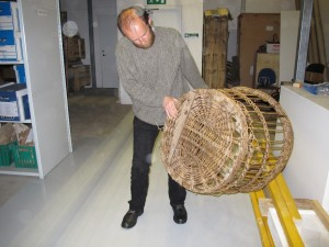 Ian Tait, Director of Shetland Museum, in the museum store, with a large wool basket
