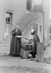 Phemie, an east coast fishwife, selling fish in Corstophine, early 1900s. Scottish Life Archive