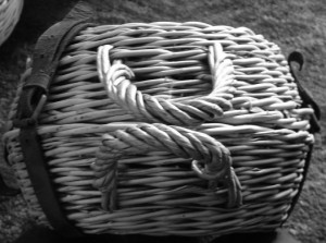 curling basket with handles on side