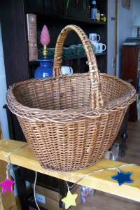 A shopping basket used in Lewis in the 1960's, 70's and 80's. Probably bought in lauder, Berweckshire
