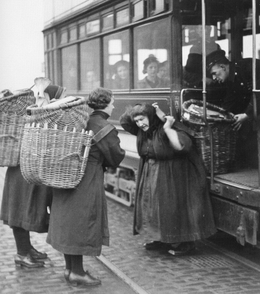 Putting creels on the tram. 1940s.