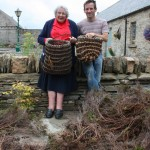 Sheila Moir with Tim Johnson and a pile of heather at the workshop