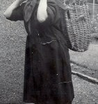 Elizabeh Ritchie in working clothes with creel.1954. Fisherrow.